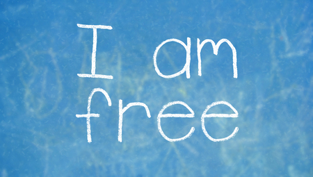 i am: I am free concept written with chalk