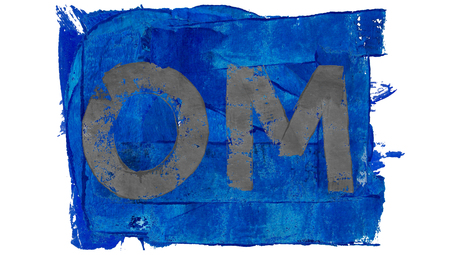 mantra: Om mantra painted on blue paint Stock Photo