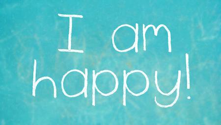 i am: I am happy chalk words written on blue