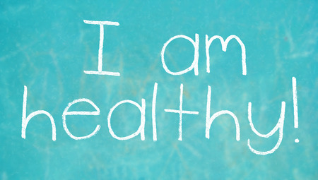 i am: I am healthy health exclamation written with chalk