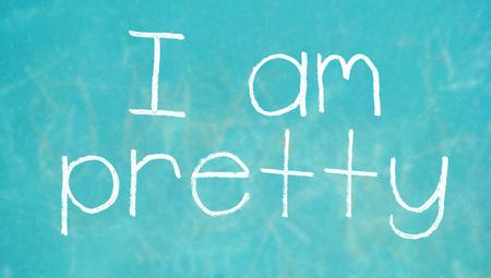 i am: I am pretty words on chalk board blue background
