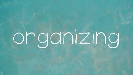 organizing: Organizing word written with chalk letters