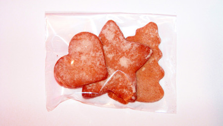 redish: Orange ginger cookies shapes for christmas present Stock Photo