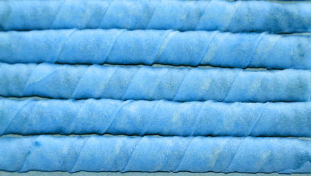 horizontals: Blue colored sweet waffle sticks candies striped background Stock Photo