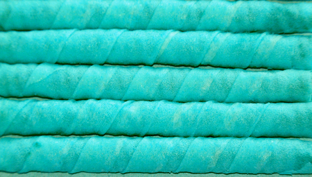 horizontals: Turquoise waffle sticks candies for party catering