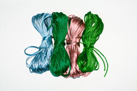 Four vegan silk yarns isolated on white Stock Photo