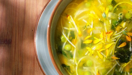 flavored: Hot noodles and peas soup bowl close up