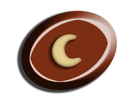 Chocolate candy with half moon of hazelnut