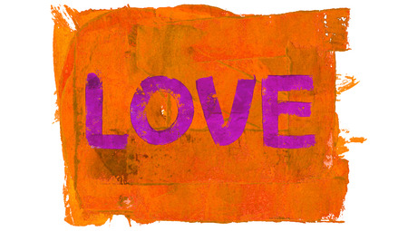 Love painted word on orange paint background