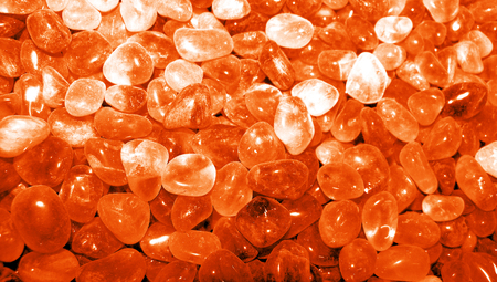 Orange stones background closeup