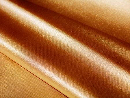 Golden diagonal lines silk cloth background