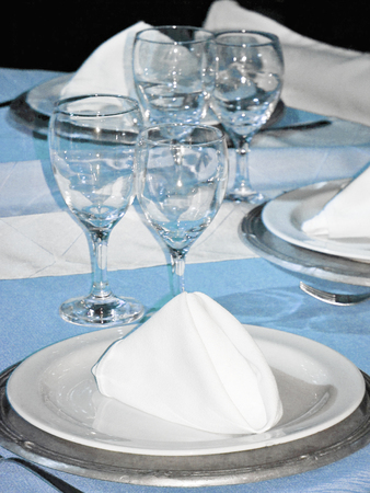 Festive table close up to a plate with a napkin Stock Photo