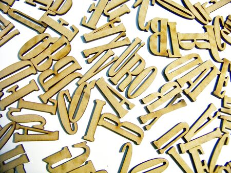 Letters shaped wood pieces backlground top view Stock Photo