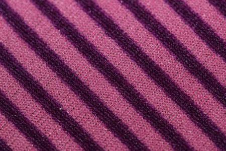 Diagonal stripes fabric violet abstract background