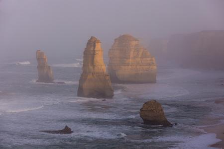 The Twelve Apostles along the Great Ocean Road, Victoria, Australia. Photographed at sunrise. Dawn fog.
