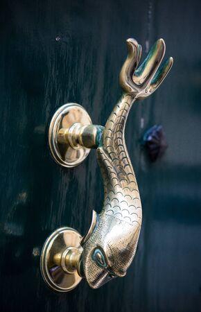 Old door dolphin handle on the green door, Valletta, Malta.