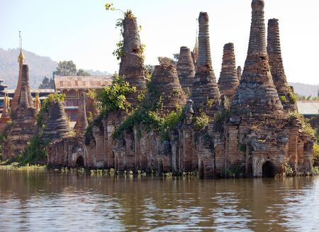 Shwe Inn Thein Paya, Indein, Nyaungshwe , Inle Lake,Shan state, myanmar Burma . Weather-beaten buddhistic zedi constructed in 17th and 18th century damaged by earthquake in 1975