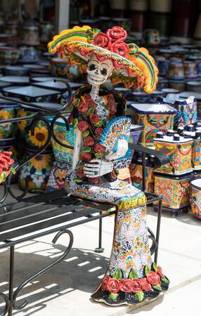 La Calavera Catrina -Mexican colorful traditional souvenirs. The symbol of the holiday of the day of the dead. Ceramic pottery Day of the Dead, Dia de los Muertos, skulls.