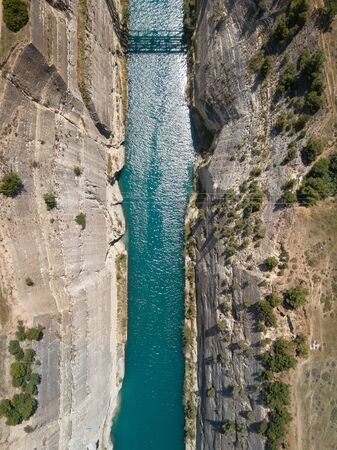 Aerial bird's eye view photo taken by drone of famous Corinth Canal with turquoise water, Peloponnese, Greece. The narrowest channel in the world and engineering marvel Archivio Fotografico