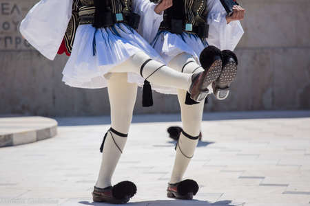 Athens, Greece - May 01, 2019: Greek soldiers Evzones dressed in traditional unusual uniforms, refers to the members of the Presidential Guard, an elite ceremonial unit. Hourly changing of the guard