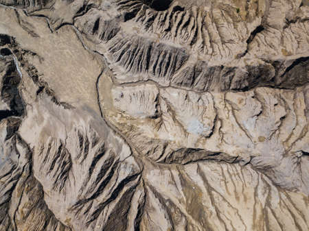 Fancy and unusual aerial landscape of Romantsev mountains wih blue lakes and mud erosion looks like alien surface of Mars. Stock Photo