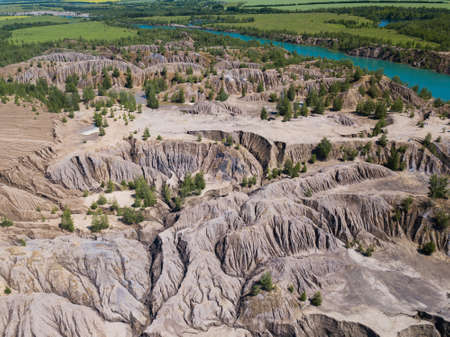 Fancy and unusual aerial landscape of Romantsev mountains wih blue lakes and mud erosion looks like alien surface of Mars.