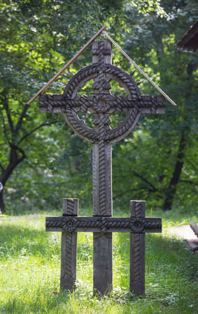 Traditional carved ancient wooden gravestone cross