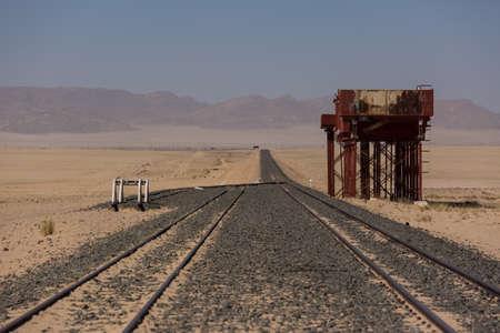Abandoned and forgotten railway being taken over by encroaching sandstorm, Kolmanskop ghost town, Namib Desert. Africa.