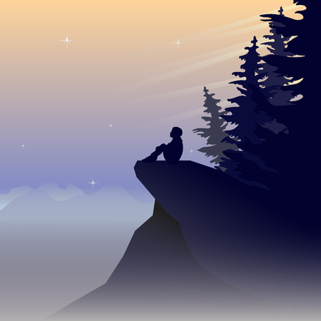 Mountain landscape in a fog with silhouettes of trees and a sitting person