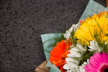 bouquet of gerberas on the wet black background place copy top view