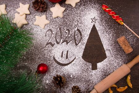 new year, christmas, 2020, flour on the table, christmas tree silhouette, star-shaped cookies, christmas decor, christmas cooking, top view, copy place, smile