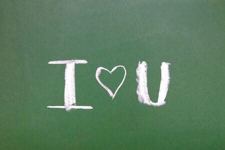 chalk inscription on green blackboard i love you, valentines day concept
