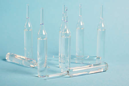 Glass ampoules close up. Medical ampoules. Medical ampoules on a blue background. Stock fotó - 154854595