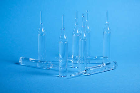 Glass ampoules close up. Medical ampoules. Medical ampoules on a blue background. Stock fotó - 154854593