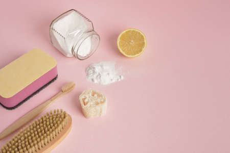 Eco friendly natural cleaning tools and products on pink background, Zero waste cleaning concept. Plastic free detergent concept Stock fotó