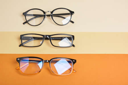 several pairs of glasses on beige and brown background, geometric background top view copy space 版權商用圖片