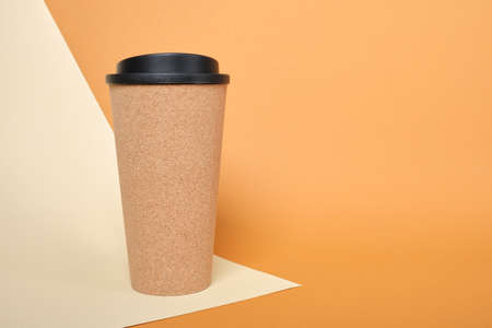 thermo mug made of cork on a beige and brown background copy space