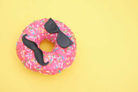 donut with sprinkles and pink icing, donut with mustache and glasses