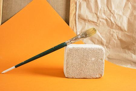 paint brush on concrete podium, art workshop concept copy space