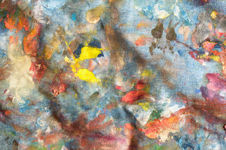 denim fabric with dried oil paint strokes, texture, artist apron