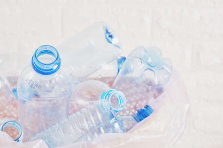 collection of plastic bottles in trash can, garbage recycling concept Banco de Imagens