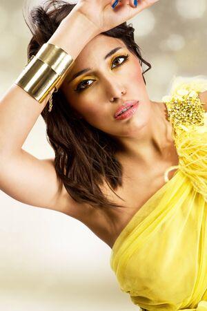 beautiful sexy young woman wearing yellow evening dress  photo