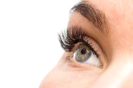 Beautiful Woman with long lashes in a beauty salon. Eyelash extension. Stock fotó