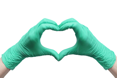 Heart made of green medical gloves, Healthy lifestyle, benefits of vitamins, vaccination, afraid of injections, medical store, pharmacy, presentation, quick recovery, useful habits, proper nutrition Stock Photo