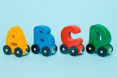 Letters A, B, C, D of a train alphabet with locomotive. Bright colors of red yellow green and blue on a white background. Early childhood education, learning to read and kids game concept Banco de Imagens - 109468695