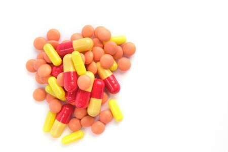 Multicolor tablets on white background. copyspace for text. Epidemic, painkillers, healthcare, treatment pills and drug abuse concept. top view. flatlay.