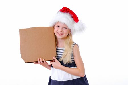 Christmas pizza and fastfood delivery.Blonde smiling girl in santa hat with pizza box in hands on white. Mock up for text or logo.