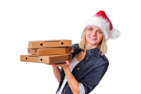 Christmas pizza and fastfood delivery. Blonde girl in santa hat with three pizza boxes in hands on white.