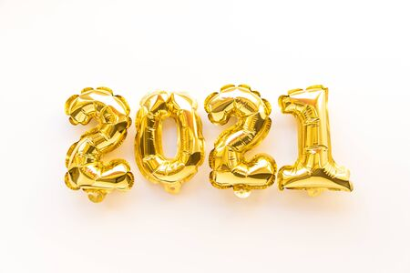 Foil balloons in the form of numbers 2021. New year celebration. Gold air balloons. Holiday party decoration. top view