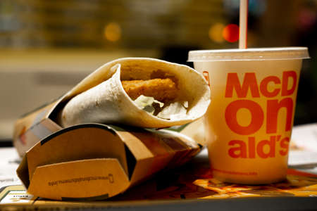 McWrap menu in McDonalds restaurant. Chicken Burrito Fanta Orange beverage. Fastfood and junk food concept. FInland, Vantaa, 28feb2020.